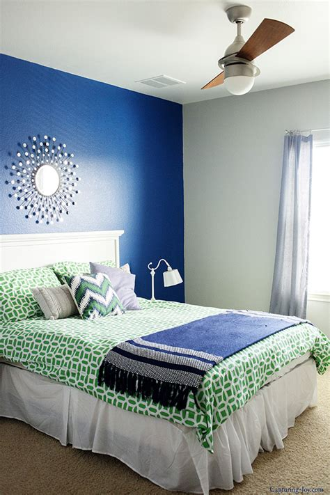 navy and green bedroom guest room makeover in progress with sherwin williams