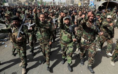 shia militiamen parade through baghdad as isis islamists