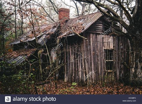 house falling apart abandoned overgrown house falling apart in the woods stock photo royalty free image