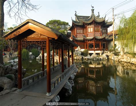 chinese home ancient chinese house on pond and bridge photo yu yuan