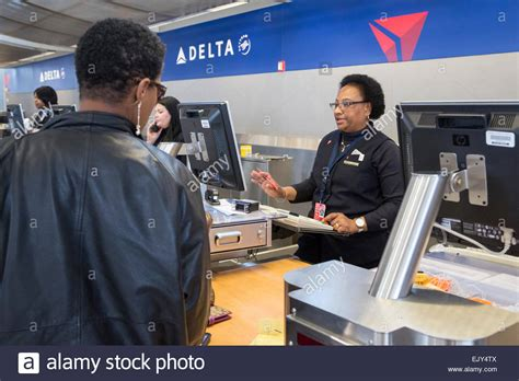 romulus michigan a delta air lines ticket agent checks