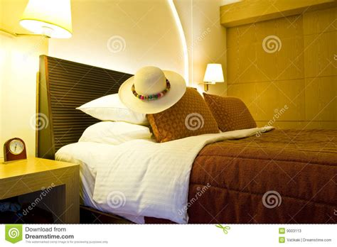 hat on the bed luxurious hotel room stock photos image 9003113