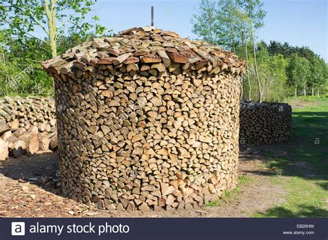 Fancy Storage Sheds holz hausen method of stacking firewood to dry stock photo