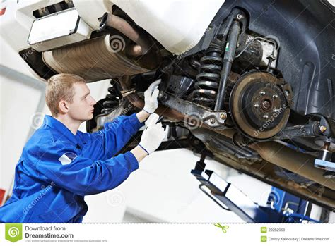 auto mechanic  car suspension repair work royalty