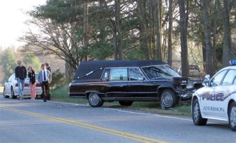car collides with hearse no one hurt