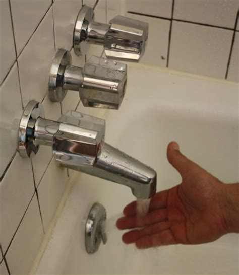 How To Change Bathtub Fixtures by How To Replace A Tub Faucet Diy