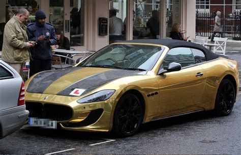 black and gold maserati drives 163 90k gold maserati around with l plates
