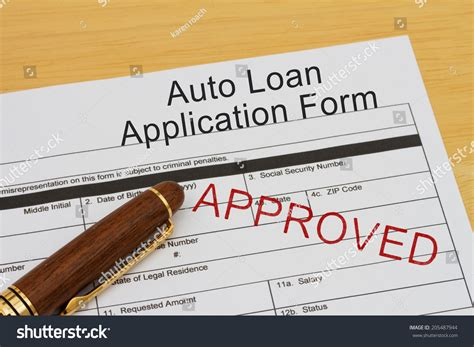 Stock Loan Desk by Auto Loan Application Form Approved St Stock Photo