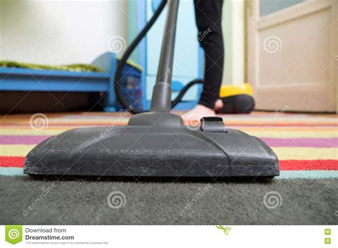 Hoovering The Floor by Cleaning Floor With Hoover Stock Photo Image 70183695