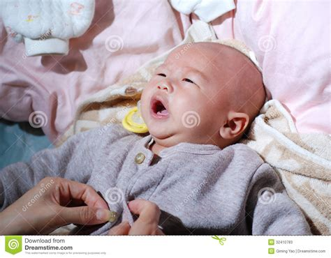 how to dress baby for bed baby dressing stock photos image 32410783