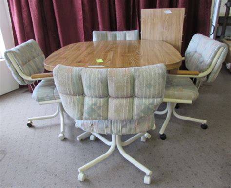 lot detail kitchen table with 4 rolling chairs