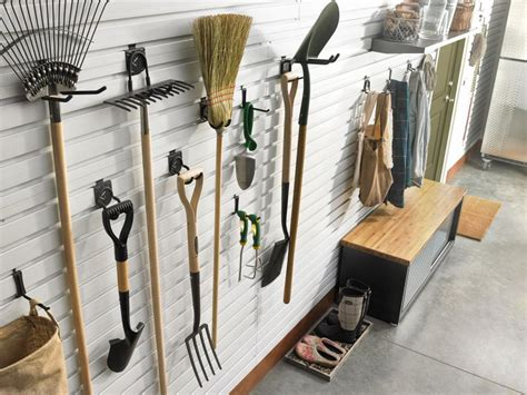 Hang Lawn Mower In Garage by Organize Lawn And Garden Tools In The Garage Hgtv