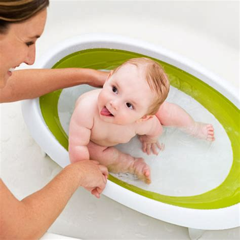 baby in a bathtub boon naked collapsible baby bathtub for newborn to toddler