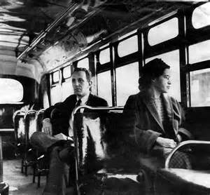 Rosa parks riding on a montgomery area transit system bus in 1956