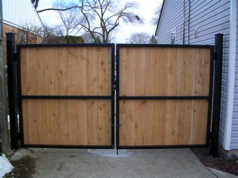steel metal gate with wooden fence boards home remodel ideas pinterest fence boards