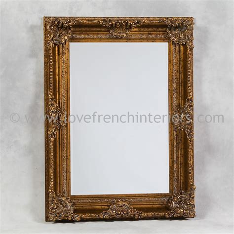 gold rectangular classic framed mirror