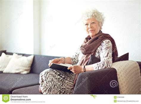 grandma couch grandmother at home sitting on the couch stock photo