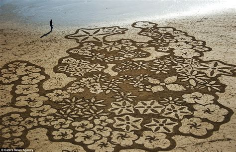 sand painting the amazing artist andres amador who starts every