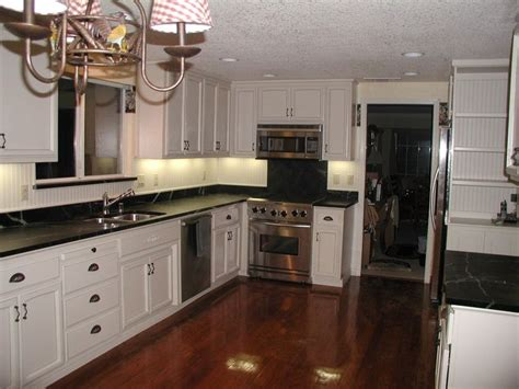 kitchen cabinets and counters kitchens with white cabinets and black countertops
