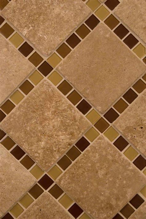 brown blend glass and tuscany walnut travertine backsplash
