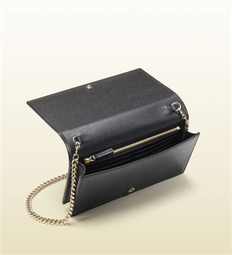 Guci Leather lyst gucci leather chain wallet in black