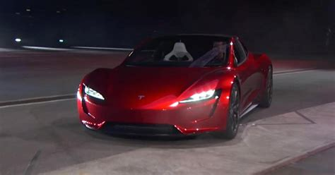 new electric car tesla tesla ceo elon musk unveils a new car a new roadster