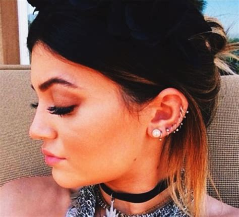 kendall jenner tattoo behind ear kylie jenners piercings all the way up her ear piercings
