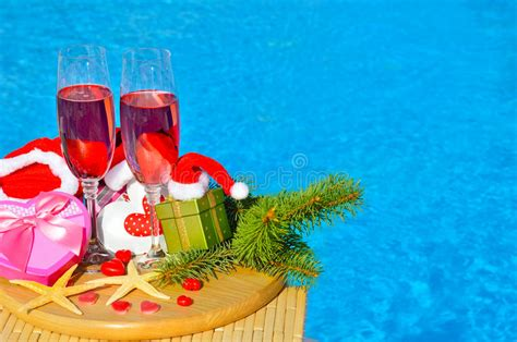 xmas pool decoration glasses with chagne and decor on swimming pool stock photo image 62947670