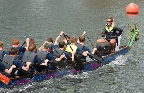dragon boat racing liverpool crews battle for glory as dragon boats race in shadow of