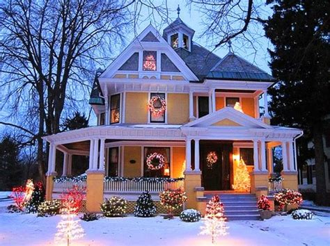 christmas house yellow victorian with outdoor lights pictures photos and