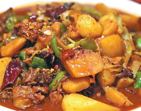 Stories To Treasure Five Tales To Delight Green the big plate chicken is a classic dish in the xinjiang