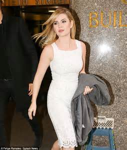 Elisha Cuthbert swaps out LBD for mini dress after Seth