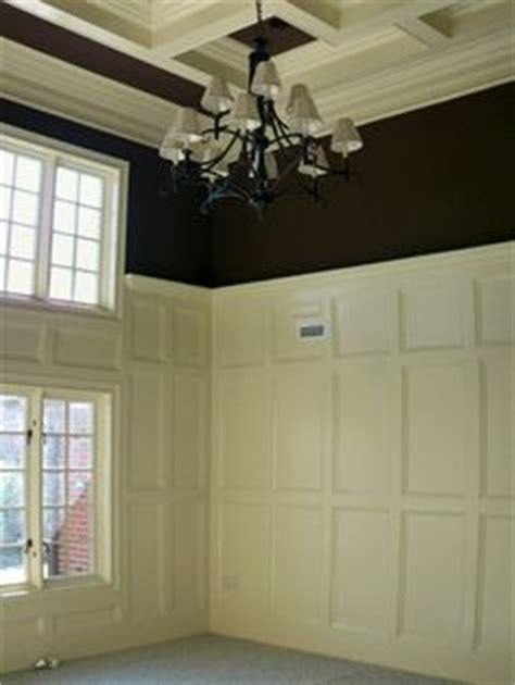 coffered walls wainscoting trim coffered ceilings railing and