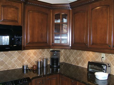kitchen backsplash cherry cabinets light colored oak cabinets with granite countertop here
