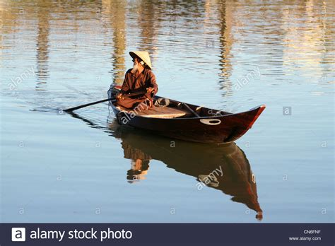 old man on boat old man in a boat in hoi an vietnam stock photo royalty