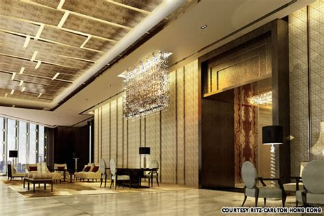living fork front desk the ritz hong kong opens up as the s highest