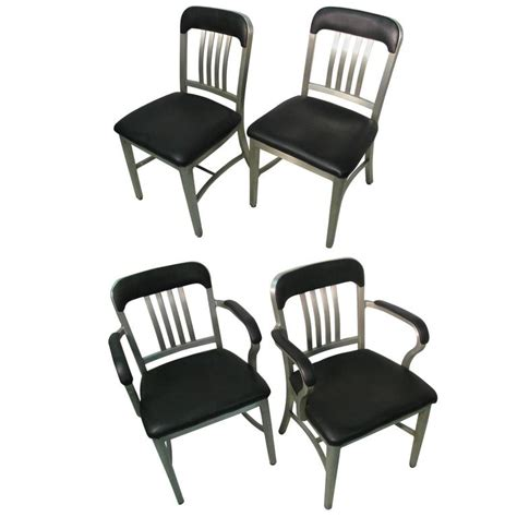 set of four aluminum goodform dining chairs by general