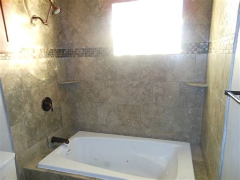 Drop In Tub With Shower Seagrass Limestone Installed On The Diagonal Above Deco