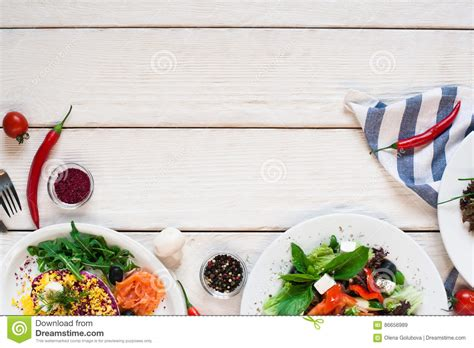 Salads Frame On White Wooden Table Flat Lay Stock Photo   Image: 86656989