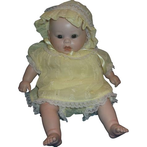 bisque porcelain doll bisque porcelain baby doll yellow dress bloomers bonnet