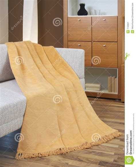draped over blanket draped over a settee stock image image 7743921