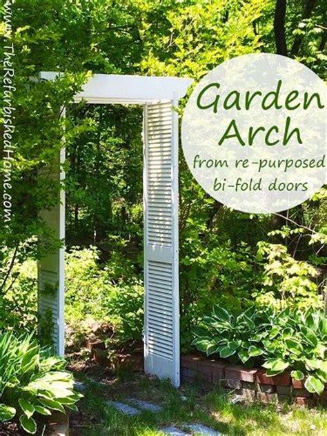 Garden Arch Made From Doors Repurposed Bi Fold Doors Become A Pergola Style Garden