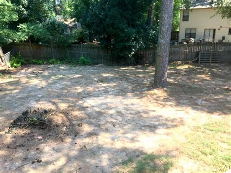 backyard leveling filling in a sinkhole and leveling my yard part 3 ugly