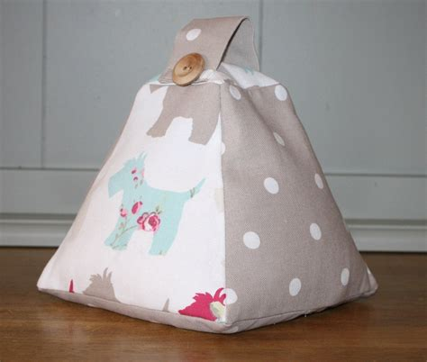 handmade shabby chic fabric doorstop in scottie dog and