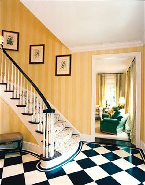 yellow foyer checkerboard floor striped walls and foyers on