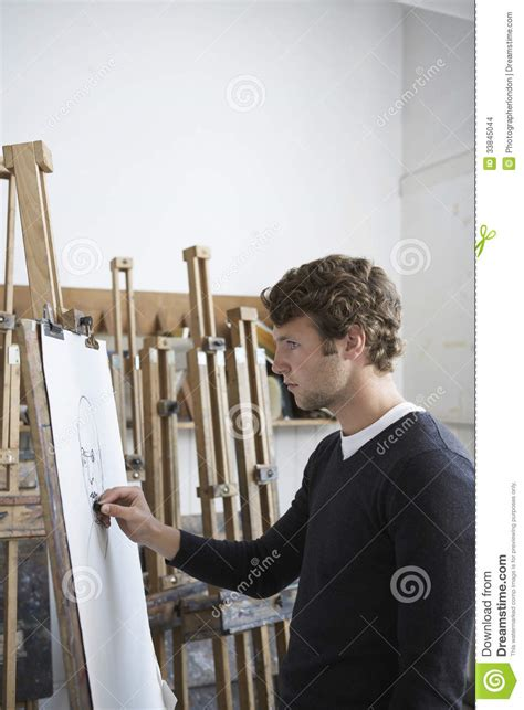 artistry of men artist drawing charcoal portrait in studio stock images