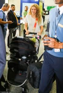 lipstick wore by shakira on commercial a glowing shakira cradles son milan as she jets into