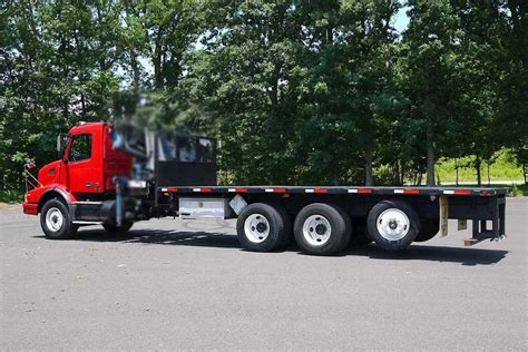 volvo truck 2003 2003 volvo vhd64f200 flatbed truck for sale 186 959