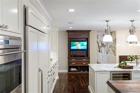 Gourmet Kitchen with TV Cabinet with Pocket Doors