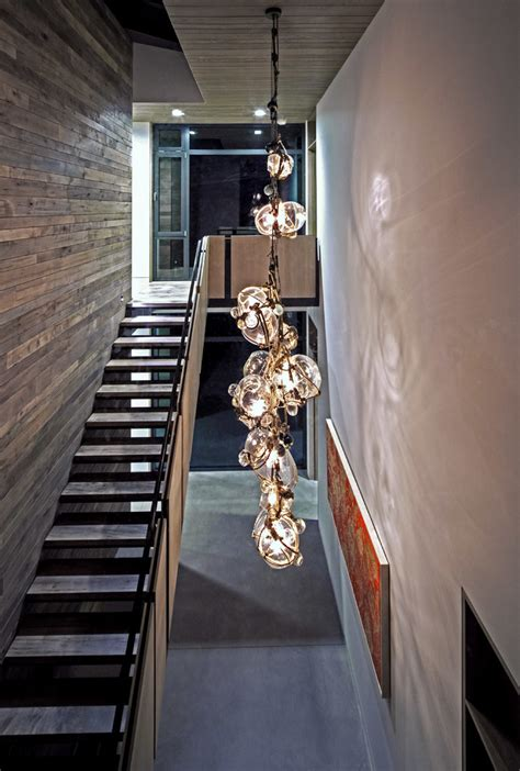 Modern hanging lights staircase contemporary with rustic wood wall reclaimed wood